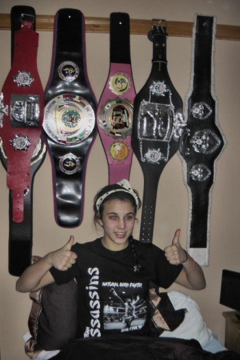 Iman Barlow and her Championship Belts