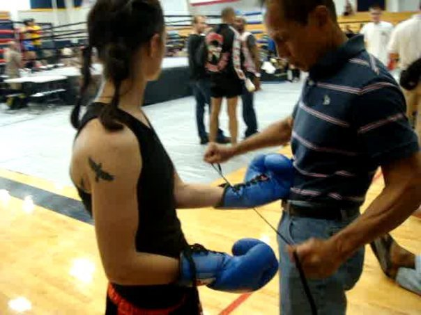 Master K lacing up my gloves for my very first fight - at the WKA's in Virgina about 4 years ago.