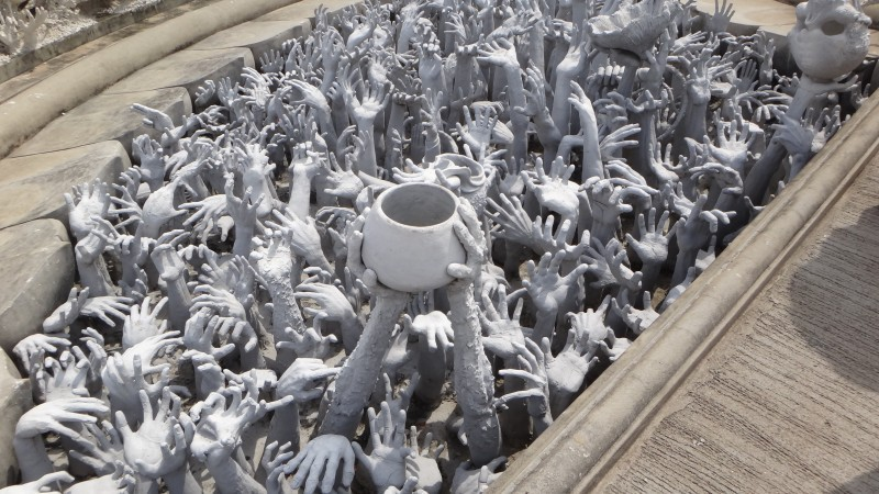 Hand with a Bowl Wat Rong Khun The White Temple