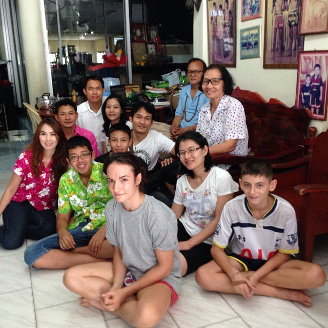 Songkran - Sylvie sitting with Petchrungruang Gym family - Pattaya