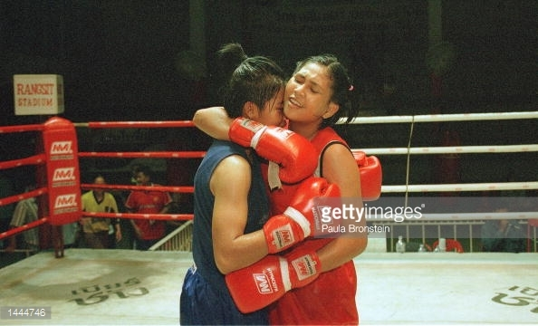female Muay Thai fighters hug - Rangsit 2000