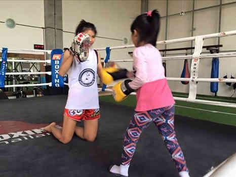 Saifah teaching little girls Muay Thai - Chiangmai Muay Thai Gym-w1400